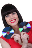 Woman holding two CD — Photo