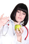 Doctor injecting an apple — Stock Photo