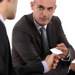 Two businessmen exchanging cards — Stock Photo #16801745