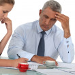 Stock Photo: Business professionals working to meet deadline