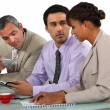 Three business having coffee during meeting — Stock Photo