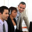 Call-center worker being trained — Stock Photo