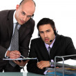 Two businessmen at the office wearing headsets — Stock Photo