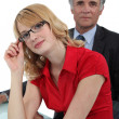 A secretary posing with her boss — Stock Photo