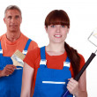 Stock Photo: Painters in overalls holding brushes
