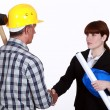 Architect shaking hands with a construction worker — Stock Photo #16806725