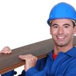 Man holding laminate floor panel — Stock Photo