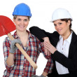 Female architect and builder - Stock Photo