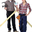 Two woodworker stood with money — Stock Photo #16807617