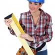 Woman using a right angle ruler - Foto Stock