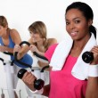 Three women in the gym — Stock Photo #16807855