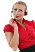 A chirpy receptionist — Stock Photo