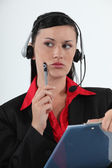Call centre agent considering her options — Foto de Stock