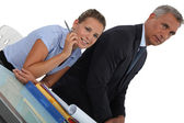 Boss sat with female assistant — Stock Photo
