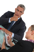 Serious businessman and his assistant — Stock Photo
