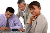 Three in business meeting — Stock Photo