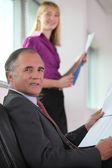 Boss running through presentation with assistant — Stock Photo