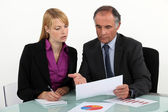 Businesspeople discussing charts — Stock Photo