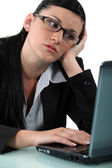 Pensive woman in front of her computer — Foto Stock