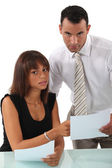 Business couple discussing paperwork — Stock Photo