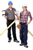 Two woodworker stood with money — Stock Photo