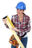 Woman using a right angle ruler — Stock Photo