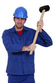 Construction worker holding a mallet — Stock Photo