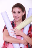 Woman charged with rolls of wallpaper — Stock Photo