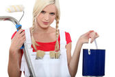 Woman in dungarees preparing to decorate — Stock Photo