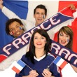 Stock Photo: Group of friends supporting French football team