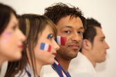 Four French sports fans stood in anticipation — 图库照片