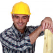 Carpenter holding planks of wood — Stock Photo #16830365