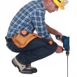 Stock Photo: Construction worker with masonry drill