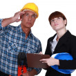 Tradesman and engineer looking at the ceiling - Stockfoto