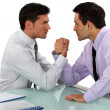 Businessmen arm wrestling — Stock Photo #16831309