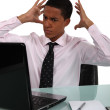 Young black businessman looking exasperated — Stock Photo