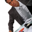 Young Afro-American businessman looking irritated — Stock Photo