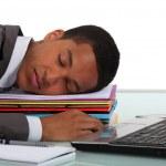Office worker asleep at desk — Stock Photo