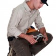 Plumber with a pair of grips — Stock Photo #16835081