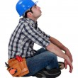 Tired manual worker taking a break - Stock Photo