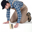 Stock Photo: Decorator peering over ledge