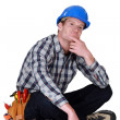 A thoughtful tradesmen - Foto Stock