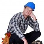 Dreamy tradesman sitting cross-legged — Stock Photo