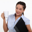 Businesswoman with a hot drink — Stock Photo