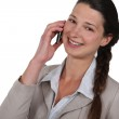 Businesswoman laughing on a mobile phone — Stock Photo