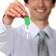 Estate agent with a key — Stock Photo #16838155