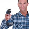 Stock Photo: Craftsmholding drill