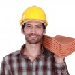 Craftsman holding roof tiles — Stock Photo