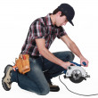 Foto Stock: Trainee holding circular saw.