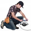 Stock Photo: Trainee holding circular saw.